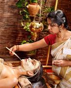 woman having mask at ayurveda spa. - stock photo