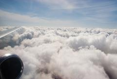 Close-up of fluffy clouds photographed from board of airplane Stock Photos