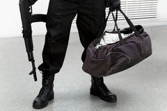 image of legs of burglar with bag full of stolen money in his hand - stock photo