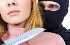 close-up of female neck with big sharp knife in killer's hand near by - stock photo