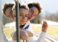 Photo of romantic couple looking out of train window and having fun Stock Photos