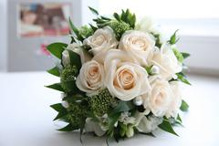 close-up of rose bouquet decorated with pearls and other decorative flowers and - stock photo