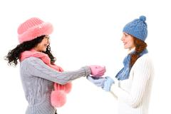 profiles of happy girl giving snow to her friend over white background - stock photo