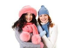 portrait of happy girls in winter clothes looking at camera - stock photo