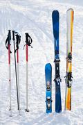 image of skis and sticks in snowdrift on winter resort - stock photo