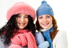 Portrait of happy girls wearing winter clothes looking at camera Stock Photos