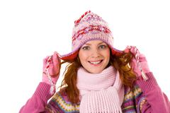 Image of pretty woman in pink winter cap posing before camera Stock Photos