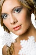 Beautiful woman decorated with snowflakes looking at camera Stock Photos