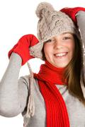 portrait of beautiful young girl wearing grey knitted cap and sweater - stock photo