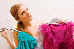 Image of pretty female thinking wat dress to wear on new year night Stock Photos