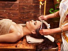 woman having ayurveda spa treatment. - stock photo