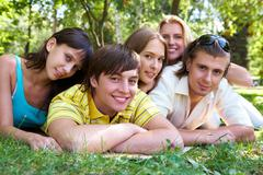 photo of several happy friends spending time together outdoors - stock photo