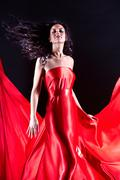 portrait of charming female wearing elegant red dress - stock photo