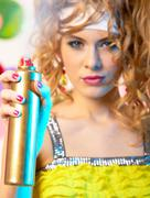 Photo of hair lacquer in hand of glamorous lady spraying it before you Stock Photos
