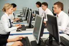 photo of confident businesspeople doing some computer work - stock photo
