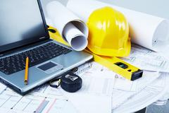 Image of laptop, architectural tools and blueprints Stock Photos