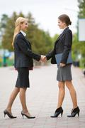 Photo of partnership - business women shaking hands at meeting Stock Photos