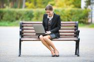 Stock Photo of image of elegant employer sitting on the bench