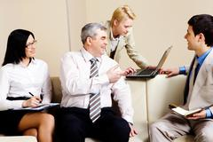 portrait of business partners communicating in office - stock photo