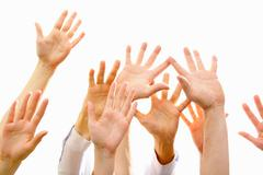 image of several raising human hands a white background - stock photo