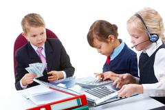 Stock Photo of photo of busy girls working at meeting with their boss holding money near by