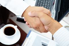 Photo of handshake of business partners after striking deal Stock Photos
