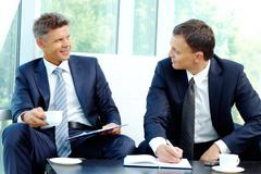 Image of smart businessmen discussing new strategy at meeting Stock Photos