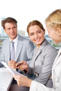 image of successful businesspeople discussing plan at meeting in office - stock photo