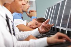 Image of tired businesswoman sleeping in working environment Stock Photos
