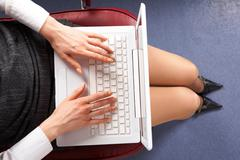 Above view of businesswoman typing on laptop in office Stock Photos