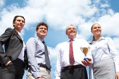 Portrait of confident business group on background of cloudy sky Stock Photos