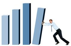 creative photo of modern businessman trying to put column of graph into place - stock photo