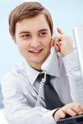Portrait of smiling agent speaking by telephone Stock Photos