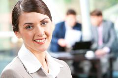 Beautiful businesswoman with smile  in a working environment Stock Photos