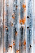 wooden fence of smoky color - stock photo