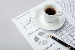 image of business document with penholder and with cup of coffee on it - stock photo