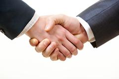 Photo of handshake of business partners after signing promising contract Stock Photos
