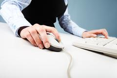 Close-up of human hand on white mouse during computer work Stock Photos