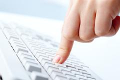 image of human forefinger on keyboard button - stock photo