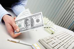 Close-up of human hand holding several dollar banknotes Stock Photos