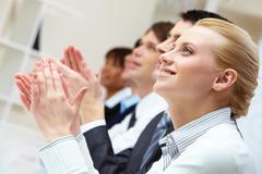 Photo of business partners hands applauding at meeting with pretty blonde at for Stock Photos