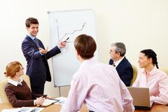 image of confident man making presentation and interacting with the audience - stock photo