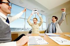 businesspeople glad for new corporate project - stock photo