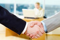 Close-up of corporate deal on the background of secretary Stock Photos
