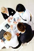 Above view of friendly workteam interacting at meeting Stock Photos