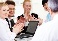 Photo of happy business partners applauding to their senior leader after making Stock Photos