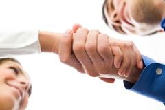 Image of partners handshake after signing contract Stock Photos