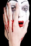 Mime with blood on face and hand Stock Photos