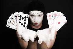 Mime with  royal flush on a black background Stock Photos