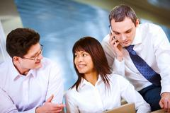 photo of confident employees interacting at working meeting - stock photo